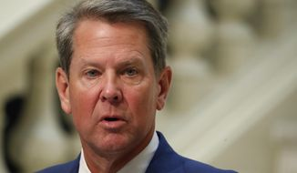 Georgia Gov. Brian Kemp speaks during a coronavirus briefing at the Capitol Friday, July 17, 2020, in Atlanta. Kemp sued the city of Atlanta over its face-mask requirement just after President Donald Trump arrived in the city without wearing a mask, Mayor Keisha Lance Bottoms said Friday.(AP Photo/John Bazemore)