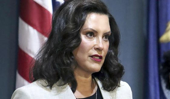 In a June 17, 2020, file photo provided by the Michigan Office of the Governor, Michigan Gov. Gretchen Whitmer addresses the state during a speech in Lansing, Mich. On Friday, July 17, 2020, Gov. Whitmer tweaked Michigan's tougher order to wear masks in public, clarifying that is not required while voting, and telling businesses that cannot assume people who enter without a face covering are covered by exceptions. The changes came a week after the Democratic governor updated the mask rule to add a maximum $500 fine and require businesses to refuse entry to those without a face covering. (Michigan Office of the Governor via AP, File)  **FILE**