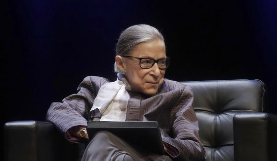In this Oct. 21, 2019, file photo U.S. Supreme Court Justice Ruth Bader Ginsburg listens to speakers during the inaugural Herma Hill Kay Memorial Lecture at the University of California at Berkeley in Berkeley, Calif. (AP Photo/Jeff Chiu, File)  **FILE**