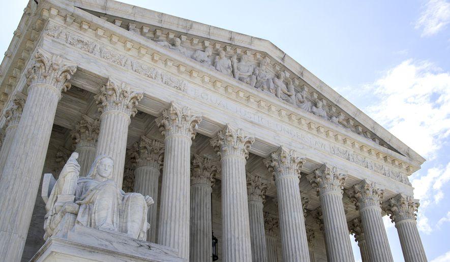 This June 30, 2020, file photo shows the U.S. Supreme Court in Washington.  (AP Photo/Manuel Balce Ceneta, File)  **FILE**
