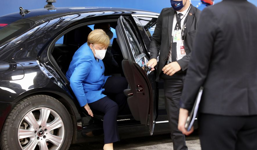 German Chancellor Angela Merkel arrives for an EU summit at the European Council building in Brussels, Saturday, July 18, 2020. Leaders from 27 European Union nations meet face-to-face for a second day of an EU summit to assess an overall budget and recovery package spread over seven years estimated at some 1.75 trillion to 1.85 trillion euros. (AP Photo/Olivier Matthys, Pool)