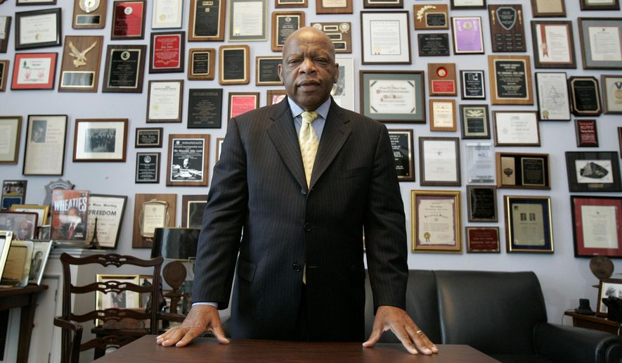 This Thursday, May 10, 2007, file photo shows U.S. Rep. John Lewis, D-Ga., in his office on Capitol Hill, in Washington. Lewis, who carried the struggle against racial discrimination from Southern battlegrounds of the 1960s to the halls of Congress, died Friday, July 17, 2020. (AP Photo/Susan Walsh, File)