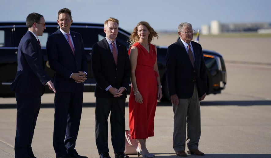 From left, Mayor G.T. Bynum, Lt. Gov. Matt Pinnell, Sen. James Lankford, R-Okla., Cindy Lankford, and Sen. Jim Inhofe, R-Okla., wait for President Donald Trump to arrive at Tulsa International Airport on Saturday, June 20, 2020, in Tulsa, Okla. (AP Photo/Evan Vucci)