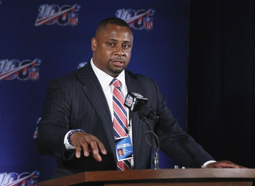 FILE - In this May 22, 2019, file photo, NFL vice president Troy Vincent speaks to the media during an owners meetings in Key Biscayne, Fla. The NFL has informed teams their training camps will open on time. League executive Troy Vincent sent a memo to general managers and head coaches on Saturday, July 18, 2020 informing them rookies are to report by Tuesday, quarterbacks and injured players by Thursday and all other players should arrive by July 28. (AP Photo/Brynn Anderson, File)