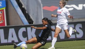 Sky Blue's Midge Purce (23) kicks the ball as Washington Spirit's Ashley Sanchez, right, defends during the first half of an NWSL Challenge Cup soccer match at Zions Bank Stadium Saturday, July 18, 2020, in Herriman, Utah. (AP Photo/Rick Bowmer)
