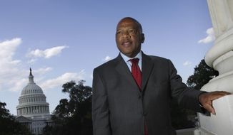 In this Wednesday, Oct. 10, 2007, file photo, with the Capitol Dome in the background, U.S. Rep. John Lewis, D-Ga., is seen on Capitol Hill in Washington. Lewis, who carried the struggle against racial discrimination from Southern battlegrounds of the 1960s to the halls of Congress, died Friday, July 17, 2020. (AP Photo/Lawrence Jackson, File)  **FILE**