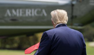 FILE - In this July 15, 2020, file photo President Donald Trump walks on the South Lawn of the White House in Washington before boarding Marine One for a short trip to Andrews Air Force Base, Md., and then on to Atlanta. President Donald Trump has taken an increasingly hands-off approach to the coronavirus crisis in recent days even as COVID-19 related deaths and positive cases have surged to record highs in a huge slice of the country, including areas where he has enjoyed strong support.(AP Photo/Patrick Semansky, File)