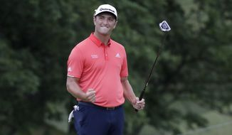 Jon Rahm, of Spain, celebrates after the 18th hole to win the Memorial golf tournament, Sunday, July 19, 2020, in Dublin, Ohio. (AP Photo/Darron Cummings)