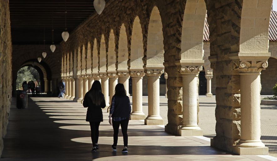 In this March 14, 2019, file photo, students walk on the Stanford University campus in Santa Clara, Calif. Even with a fresh victory on behalf of international students, U.S. universities fear they're losing a broader fight over the nation's reputation as a place that embraces and fosters the world's best scholars. (AP Photo/Ben Margot, File)