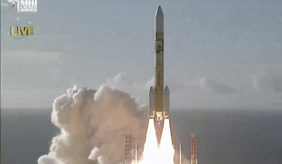 In this image made from MHI's youtube channel, the H-IIA rocket with United Arab Emirates' Mars orbiter Hope lifts off from Tanegashima Space Center in Minamitane, southern Japan, Monday, July 20, 2020. (MHI via AP)