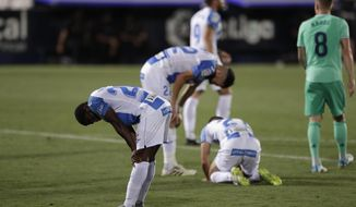 Leganes' players react after the Spanish La Liga soccer match between Leganes and Real Madrid at the Butarque Stadium in Leganes, on the outskirts of Madrid, Spain, Sunday, July 19, 2020. The match ended 2-2 draw, and Leganes being relegated from La Liga to the second division. (AP Photo/Bernat Armangue)