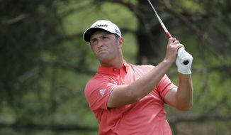 Jon Rahm, of Spain, hits from the second tee during the final round of the Memorial golf tournament, Sunday, July 19, 2020, in Dublin, Ohio. (AP Photo/Darron Cummings)