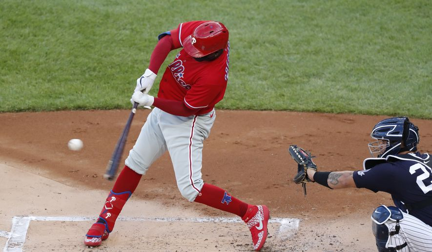 Philadelphia Phillies Didi Gregorius hits a double during the first inning an exhibition baseball game against the New York Yankees, Monday, July 20, 2020, at Yankee Stadium in New York. Yankees catcher Gary Sanchez (24) is behind the plate. (AP Photo/Kathy Willens)