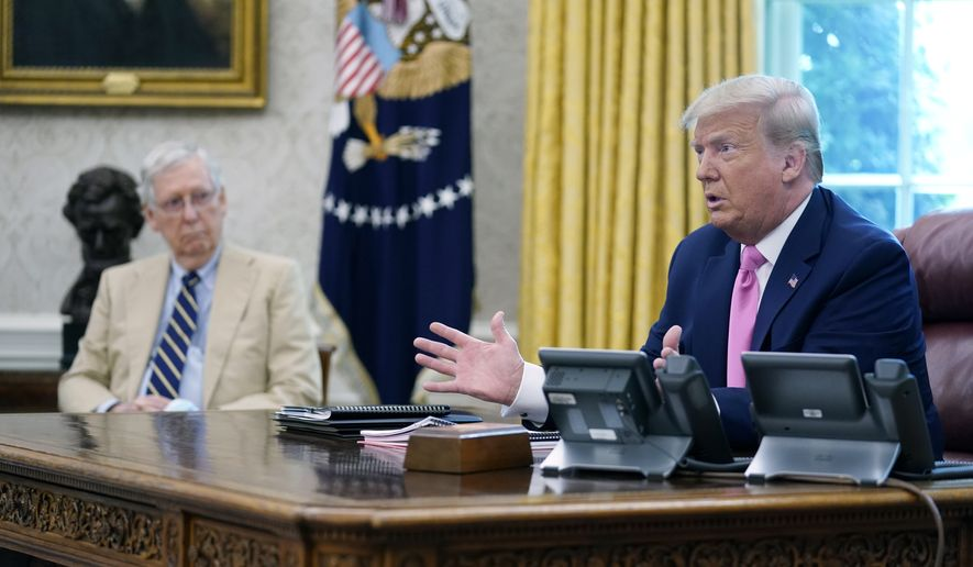 President Donald Trump meets with Senate Majority Leader Mitch McConnell, shown left, and House Minority Leader Kevin McCarthy, not shown, in the Oval Office at the White House, Monday, July 20, 2020, in Washington. (AP Photo/Evan Vucci)