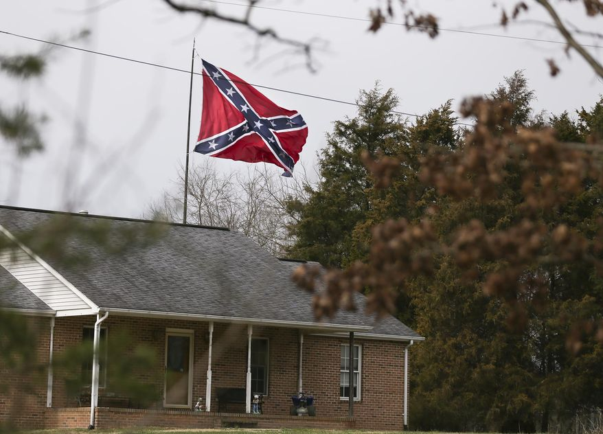 The Confederate flag along I-95 in south Stafford seen from Beagle Road on Wednesday, Feb. 28, 2018. Confederate flag that hangs from an 80-foot pole along I-95 in Virginia is once again drawing the ire of some local residents.  (Peter Cihelka/The Free Lance-Star via AP)