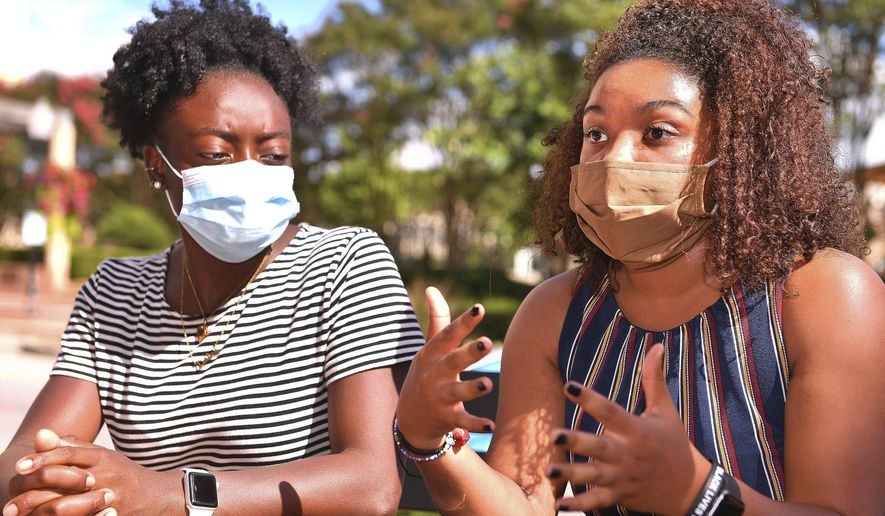Members of the Wofford Anti-Racism Coalition, including Destiny Shippy, left, and Naya Taylor, right, talk about some of their grievances with Wofford College, in Spartanburg, S.C., Thursday, July 9, 2020. (Tim Kimzey/Spartanburg Herald-Journal via AP)