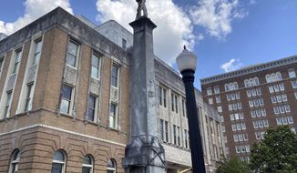 In this Tuesday, June 16, 2020 photo, a Confederate monument is pictured in front of the Lauderdale County Courthouse in Meridian, Miss. A group is calling for the removal of the monument. (Bill Graham/The Meridian Star via AP)