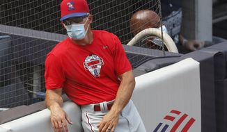 Philadelphia Phillies manager Joe Girardi leans against the stands during batting practice before an exhibition baseball game against his former team, the New York Yankees, Monday, July 20, 2020, at Yankee Stadium in New York. (AP Photo/Kathy Willens)