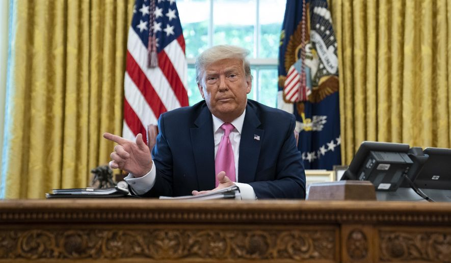 President Donald Trump points to the door as reporters are escorted out of a meeting with with Senate Majority Leader Mitch McConnell of Ky., and House Minority Leader Kevin McCarthy of Calif., in the Oval Office of the White House, Monday, July 20, 2020, in Washington. (AP Photo/Evan Vucci)