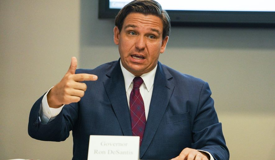 Florida Gov. Ron DeSantis answers questions during a roundtable discussion held alongside First Lady Casey DeSantis, regarding mental health and COVID-19 at the Tampa Bay Crisis Center on Thursday, July 16, 2020 in Tampa. (Martha Asencio-Rhine/Tampa Bay Times via AP)