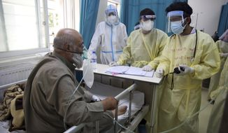 A patient is connected to an oxygen tank in the Intensive Care Unit ward for COVID-19 patients at the Afghan-Japan Communicable Disease Hospital in Kabul, Afghanistan, Tuesday June 30, 2020. (AP Photo/Rahmat Gul)