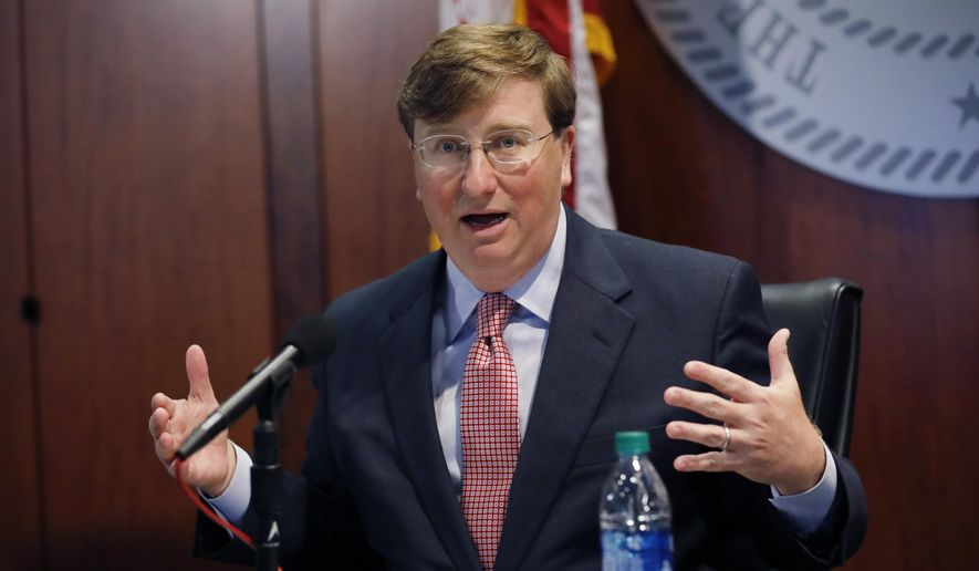 Mississippi Gov. Tate Reeves expresses his concern over the growing number of people testing positive with coronavirus statewide, during a press briefing with members of the state's COVID-19 response team, Monday, July 20, 2020, in Jackson, Miss. (AP Photo/Rogelio V. Solis)