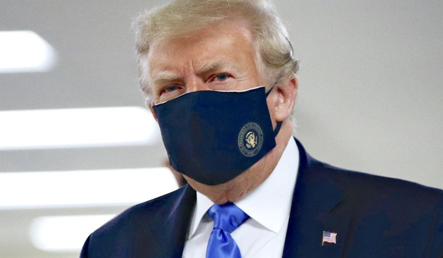 """President Trump wore a mask last week. His wearing one """"has nothing to do with politics,"""" according to press secretary Kayleigh McEnany. (Associated Press)"""