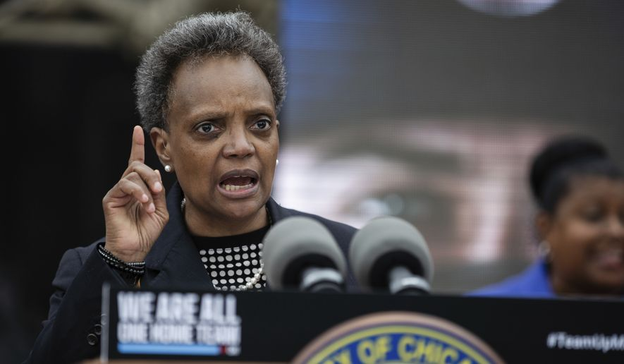 """Chicago Mayor Lori Lightfoot speaks about how she would respond if President Donald Trump deploys federal forces to Chicago, during a press conference at the Guaranteed Rate Field, home of the White Sox, Tuesday, July 21, 2020. Lightfoot launched an awareness campaign called """"We Are All One Team"""" that encourages young people to wear masks, maintain social distance and stop gathering in large groups to help prevent the spread of COVID-19. (Pat Nabong/Chicago Sun-Times via AP)"""