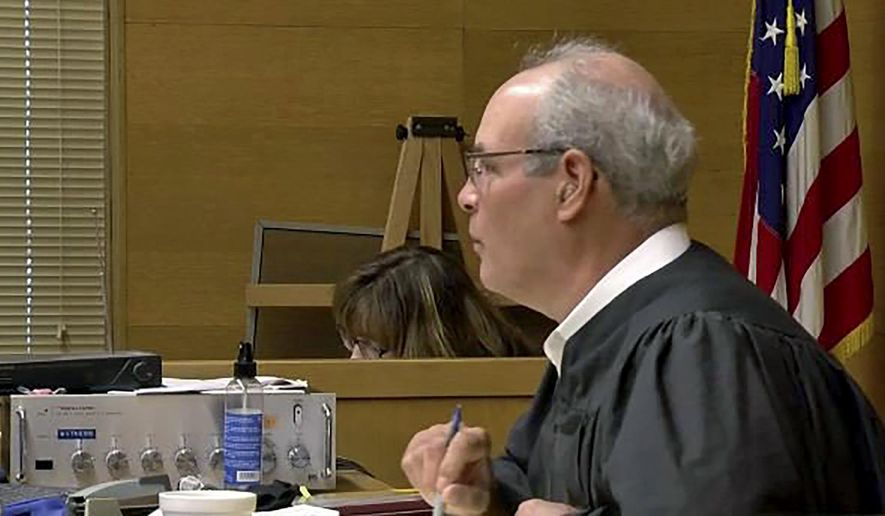 FILE - This undated still file image from video provided by WTOV-TV in Steubenville, Ohio, shows Jefferson County, Ohio, Judge Joseph Bruzzese Jr. The Ohio Supreme Court plans to hear oral arguments Tuesday, July 21, 2020, in an appeal by The Associated Press of a ruling that prevented the release of surveillance video showing Bruzzese being shot and wounded.  (WTOV-TV via AP, File)