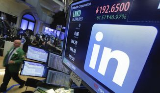 In this Monday, June 13, 2016, photo, the LinkedIn logo appears on a screen at the post where it trades on the floor of the New York Stock Exchange. (AP Photo/Richard Drew) **FILE**