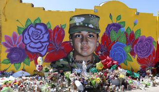"Offerings sit in front of a mural of slain Army Spc. Vanessa Guillen painted on a wall in the south side of Fort Worth, Texas, Saturday, July 11, 2020. A key House committee will examine whether Fort Hood is in a full-blown ""crisis"" of sexual harassment and retaliation following the recent death of Guillen. (AP Photo/LM Otero)  **FILE**"