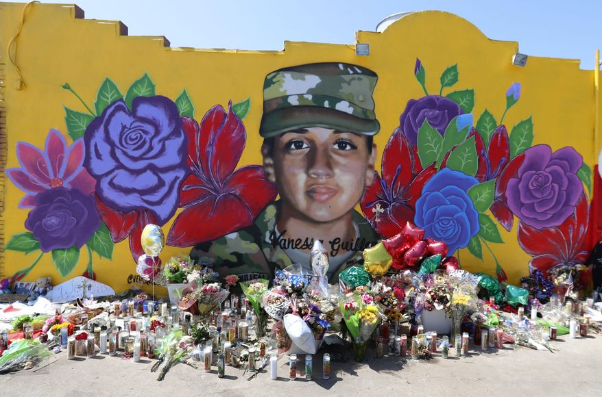 """Offerings sit in front of a mural of slain Army Spc. Vanessa Guillen painted on a wall in the south side of Fort Worth, Texas, Saturday, July 11, 2020. A key House committee will examine whether Fort Hood is in a full-blown """"crisis"""" of sexual harassment and retaliation following the recent death of Guillen. (AP Photo/LM Otero)  **FILE**"""