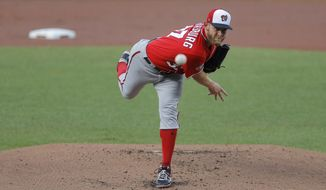 Washington Nationals starting pitcher Stephen Strasburg delivers against the Baltimore Orioles during an exhibition baseball game Monday, July 20, 2020, in Baltimore. (AP Photo/Julio Cortez)