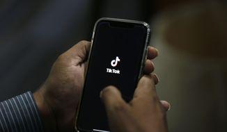 "A man opens social media app ""TikTok"" on his cellphone, in Islamabad, Pakistan, Tuesday, July 21, 2020. (AP Photo/Anjum Naveed)"