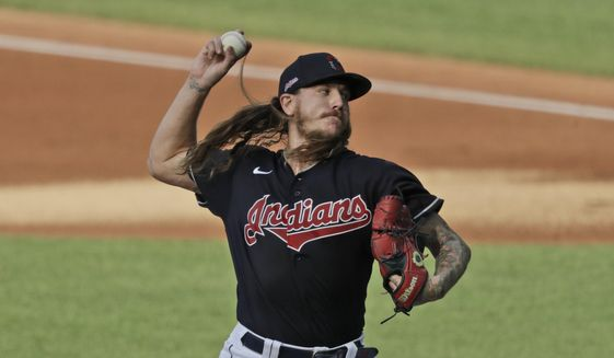 Cleveland Indians starting pitcher Mike Clevinger delivers in the first inning during a preseason baseball game against the Pittsburgh Pirates, Monday, July 20, 2020, in Cleveland. (AP Photo/Tony Dejak)