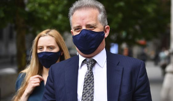 Christopher Steele, a former British spy who wrote a 2016 dossier about alleged links between Donald Trump and Vladimir Putin, leaves the High Court in London following a hearing in the libel case brought against him by Russian businessman Aleksej Gubarev,  Wednesday July 22, 2020. A key sub-source for material in the Steele dossier has been unmasked: Igor Danchenko, a Ukraine-born think-tank analyst. (Victoria Jones/PA via AP)  **FILE**