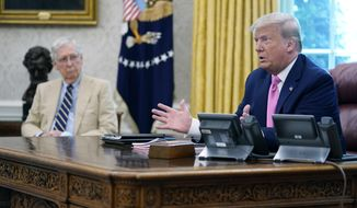 Then-President Donald Trump meets with Senate Majority Leader Mitch McConnell, shown left, and House Minority Leader Kevin McCarthy, not shown, in the Oval Office at the White House, Monday, July 20, 2020, in Washington. (AP Photo/Evan Vucci) ** FILE **