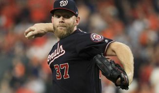 FILE - In this Oct. 29, 2019, file photo, Washington Nationals starting pitcher Stephen Strasburg throws against the Houston Astros during the first inning of Game 6 of the baseball World Series in Houston. Max Scherzer, Strasburg and the rest of the Nationals head into the 2020 season hoping to do something no major league club has done in quite some time: win back-to-back World Series. (AP Photo/Mike Ehrmann, Pool, File)