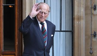 Britain's Prince Philip The Duke of Edinburgh arrives for a ceremony for the transfer of the Colonel-in-Chief of the Rifles from the Duke to the Camilla Duchess of Cornwall, who will conclude the ceremony from Highgrove House, at Windsor Castle, England, Wednesday July 22, 2020. The ceremony will begin at Windsor Castle where the Assistant Colonel Commandant, Major General Tom Copinger-Symes, will offer the salute and thank the Duke for his 67 years of support and service to The Rifles, and their forming and antecedent Regiments. The ceremony will continue at Highgrove House, with Camilla The Duchess of Cornwall, where she will be addressed by The Rifles' Colonel Commandant. (Adrian Dennis/Pool via AP)
