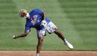 New York Mets starting pitcher Marcus Stroman throws from one leg during fielding drills at a summer baseball training camp workout at CitiField, Thursday, July 9, 2020, in New York. (AP Photo/Kathy Willens)  **FILE**