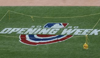 An opening week logo is displayed at Citi Field during the New York Mets baseball practice, Wednesday, July 22, 2020, in New York. The Mets open the season in Friday against the Atlanta Braves. (AP Photo/Kathy Willens)