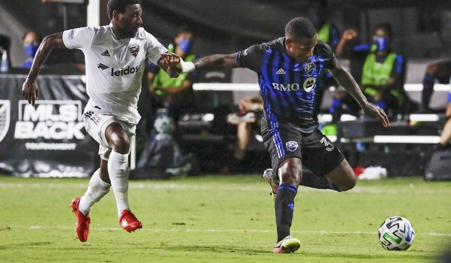 Montreal Impact forward Romell Quioto, right, tries to get off a shot in front of D.C. United defender Chris Odoi-Atsem, left, during the first half of an MLS soccer match, Tuesday, July 21, 2020, in Kissimmee, Fla. (AP Photo/John Raoux) ** FILE **
