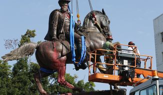 Crews prepare to remove a statue Confederate General J.E.B. Stuart on Monument Avenue in Richmond, Va. on July 7, 2020. (AP Photo/Steve Helber, File)