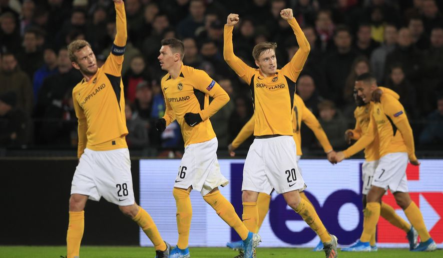 FILE - In this Thursday, Nov. 7, 2019 file photo, Young Boys players celebrate scoring their side's first goal during a Europa League group G soccer match against Feyenoord at De Kuip stadium in Rotterdam, Netherlands.Switzerland will be the last pandemic-delayed European league to complete its 2019-20 season. Title contenders Young Boys and St. Gallen kick off at 8:30 p.m. on the final Monday, July 27, 2020 for what could be a decisive match. Defending champion Young Boys leads by two points ahead of its final four games in 12 days. (AP Photo/Peter Dejong, file)