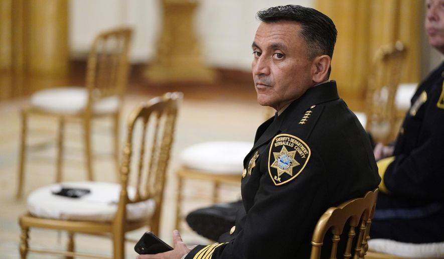 """Bernalillo County Sheriff Manuel Gonzales waits for an event on """"Operation Legend: Combatting Violent Crime in American Cities,"""" to begin in the East Room of the White House, Wednesday, July 22, 2020, in Washington. (AP Photo/Evan Vucci)"""