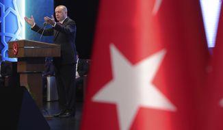 Turkey's President Recep Tayyip Erdogan delivers a speech during an event in Ankara, Turkey, Tuesday, July 21, 2020. (Turkish Presidency via AP, Pool)