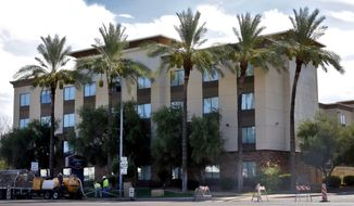 A Hampton Inn is shown Tuesday, July 21, 2020, in Phoenix. The Trump administration is detaining immigrant children as young as 1 in hotels before deporting them to their home countries. Documents obtained by The Associated Press show a private contractor hired by U.S. Immigration and Customs Enforcement is taking children to three Hampton Inns in Arizona and Texas under restrictive border policies implemented during the coronavirus pandemic. (AP Photo/Matt York)