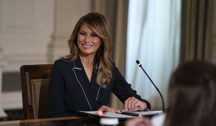 """First lady Melania Trump receives an Indian Health Service (IHS) Task Force briefing on """"Protecting Native American Children in the Indian Health System"""" at the White House in Washington, Thursday, July 23, 2020. (AP Photo/Carolyn Kaster)"""