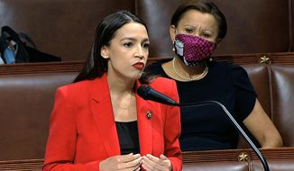 Rep. Alexandria Ocasio-Cortez, D-N.Y., speaks on the House floor, Thursday, July 23, 2020 on Capitol Hill in Washington. Ocasio-Cortez's objections to a Republican lawmaker's verbal assault on her expanded Thursday as she and other Democrats took to the House floor to demand an end to a sexist culture of accepting violence and violent language against women.  Rep. Nydia Velázquez, D-N.Y., is seated right. (House Television via AP)  ** FILE **
