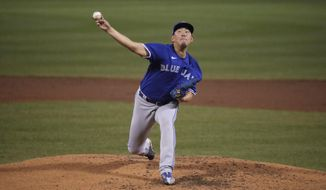 Toronto Blue Jays pitcher Shun Yamaguchi delivers during the fourth inning of an exhibition baseball game against the Boston Red Sox, Wednesday, July 22, 2020, at Fenway Park in Boston. (AP Photo/Charles Krupa)  **FILE**